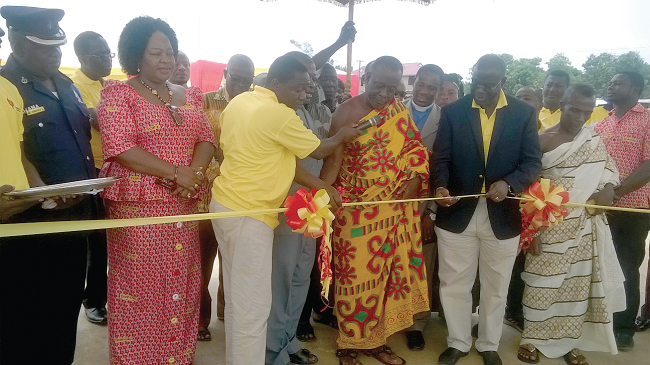Barima Narteh Anoma and Mr Dari cutting the tape to open the shopping centre at the new fuel station