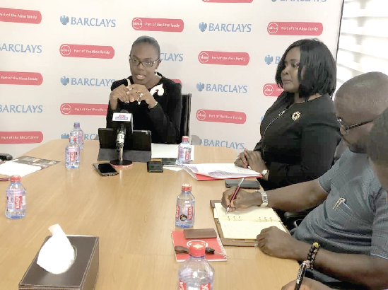 Ms Osei-Poku (left ) addressing the media as the bank released its financials for the year ending December 31, 2018