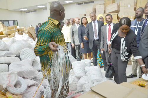 Prof. Alex Dodoo (left), Director General of GSA, showing the Parliametary Select Committee on Trade and Industry some fake cables during a tour