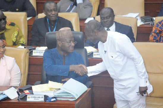 Mr Osei Kyei-Mensah-Bonsu (left), Majority Leader, congratulating Mr Ken Ofori-Atta after the presentation