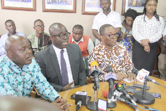Dr William Owuraku Aidoo (2nd left) addressing the media