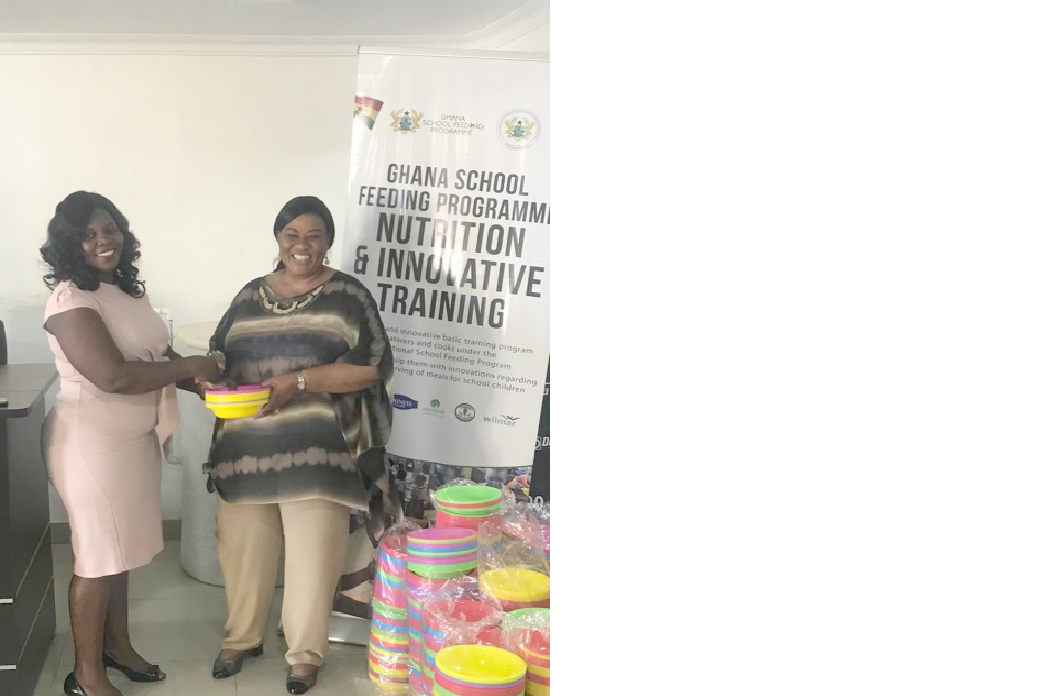 Mrs Sylvia Adadey (left) presenting the items to Mrs Getrude Quashigah