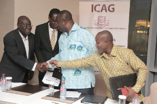 Prof. Kwame Adom Frimpong (3rd left), President, Institute of Chartered Accountants Ghana (ICAG), interacting with Mr Emmanuel Ashong-Katai (left), Head of Policy and Research, Security and Exchange Commission, Dr Benjamin Amoah (2nd left), Lecture, Central University and Dr Settor Amediku, Head of Payment Systems, Bank of Ghana after the lecture.