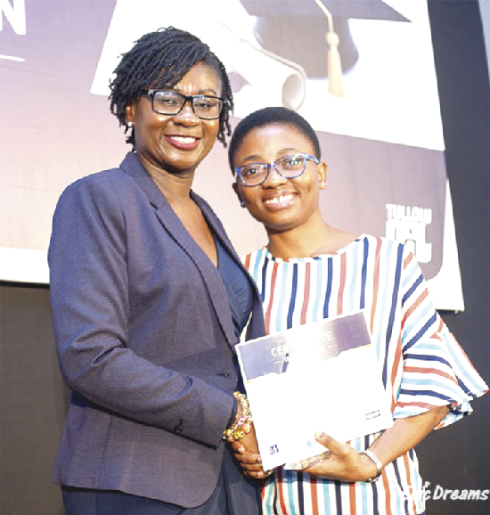 Mrs Irene Asare (left), presenting a certificate to one of the mentees.