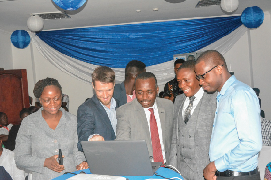 Mrs Rosy Fynn(2nd left), General Manager,BIMA, Mr Damian Gueroult (left), Country Manager, BIMA, Mr Kofi Andoh (middle), Deputy Commissioner, NIC, launching the B-Life and B-Health insurance products. Looking on are Mr Gideon Ataraire (right)of Allianz Insurance and Dr Sunu (2nd right), Lead Medical Officer, BIMA Doctor