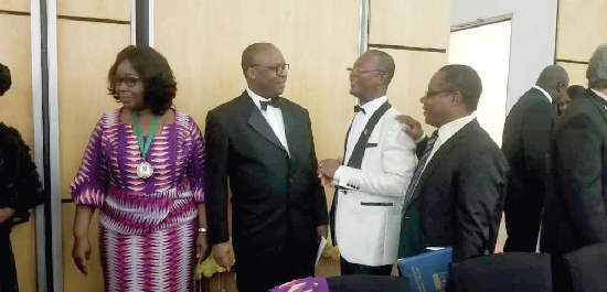 Dr Ernest Addison (2nd left), Governor, BoG, exchanging pleasantries with some executives of the Chartered Institute of Bankers at the 2018 Annual Bankers' Dinner. On the left is Reverend Mrs Patricia Sappor, President of the institute