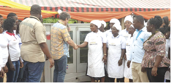 • Mr Adriano Sobreira (2nd left) interacting with the beneficiaries