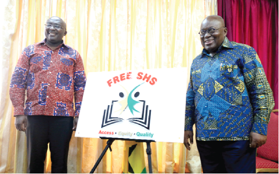 President Akufo-Addo and Vice President Mahamudu Bawumia in a pose for the cameras with the Free SHS Logo at the Flagstaff House.