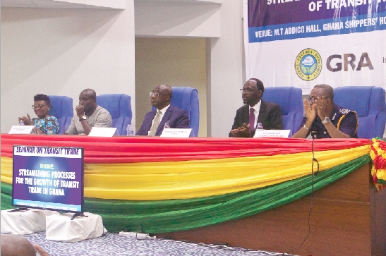 Mr Isaac Crentsil (1st right), Commissioner of Customs, Mr Emmanuel Kofi Nti (3rd left), Commissioner General, GRA, Mr Daniel Nii Kwartei Titus-Glover (2nd left), Deputy Transport Minister, and Ms Benonita Bismarck (1st left), CEO, GSA listening to participants as they shared their opinions on transit trade.