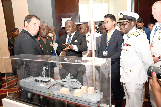 Mr Dominic Nitiwul (middle), Minister of Defense, inspecting a miniature ship at the stand of the Isreal Shipyards Limited during an exhibition which was mounted as part of the International Maritime Defence Exhibition and Conference. With him are Mr Oded Breier (left), Vice-President of Israel Shipyard Limited and Real Admiral Seth Amoama (2nd left), Chief of the Naval Staff. Picture: EBOW HANSON