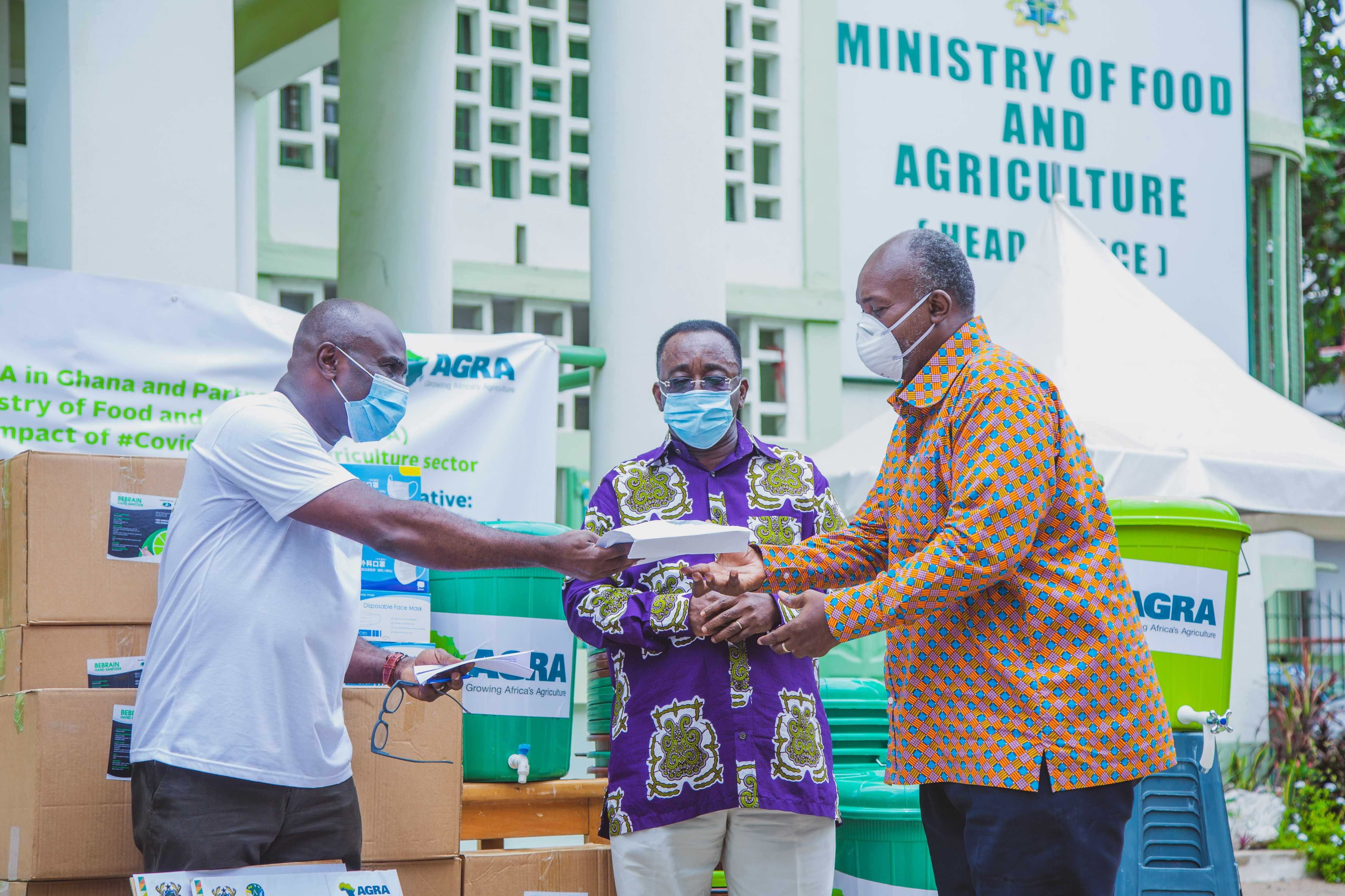 Mr Foster K. Boateng, West Africa Head of AGRA, making a presentation to Mr Patrick Robert Ankobiah, Chief Director at MOFA, while Dr Owusu Afriyie Akoto, Minister of Food and Agriculture looks on