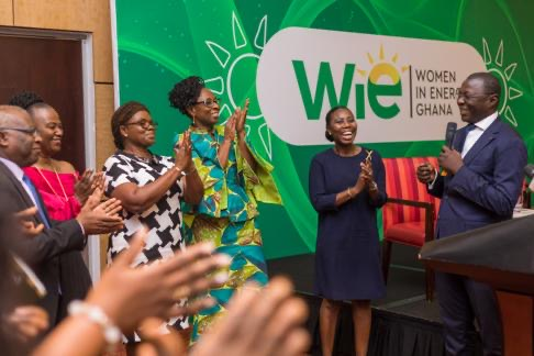 Dr Mohammed Amin Adam (right), Deputy Minister of Energy in charge of Petroleum inaugurating the WiE Ghana Board after the launch.
