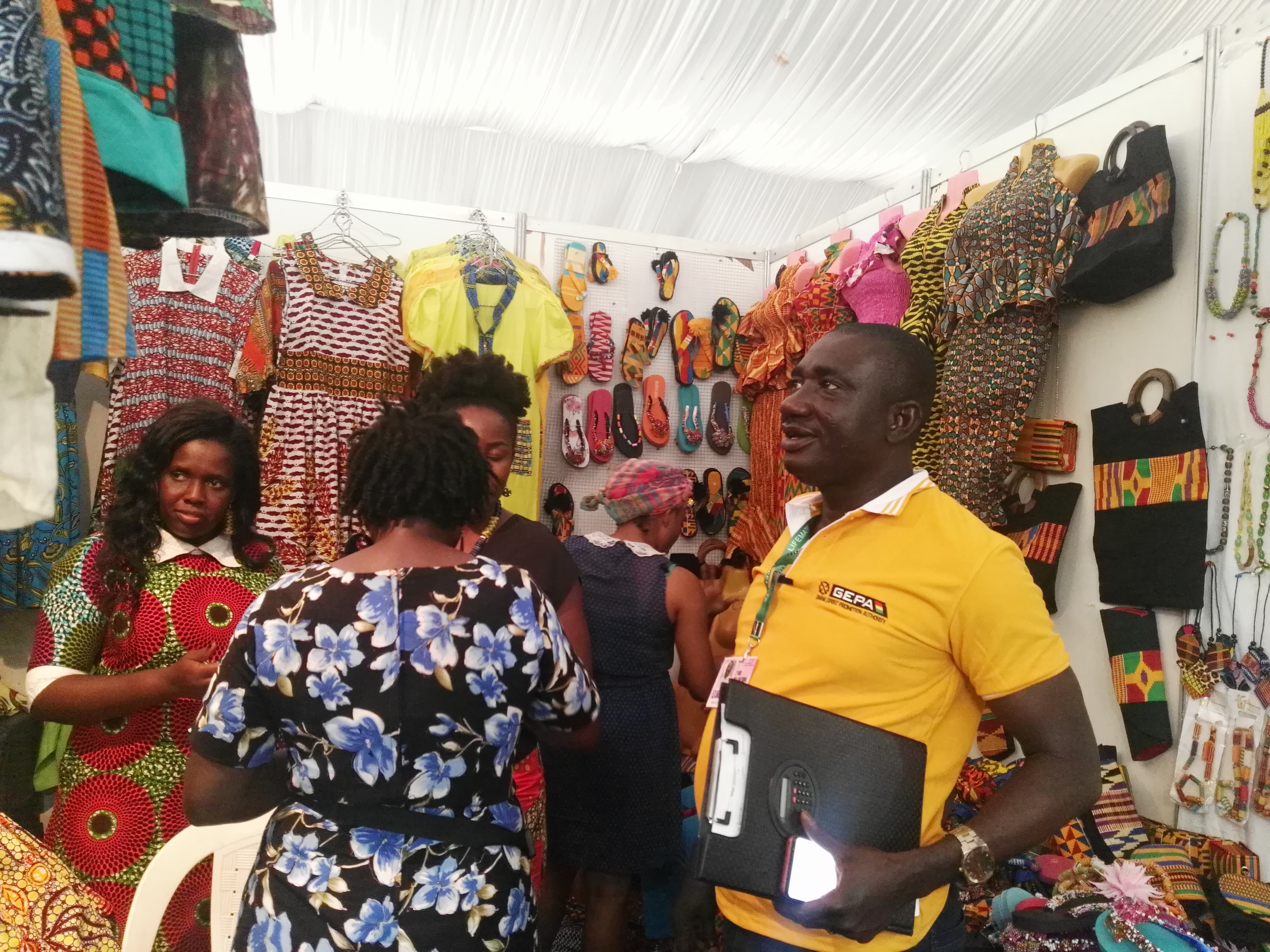 Mr Maxwell Osei-kusi interacting with a Ghanaian  exhibitor.