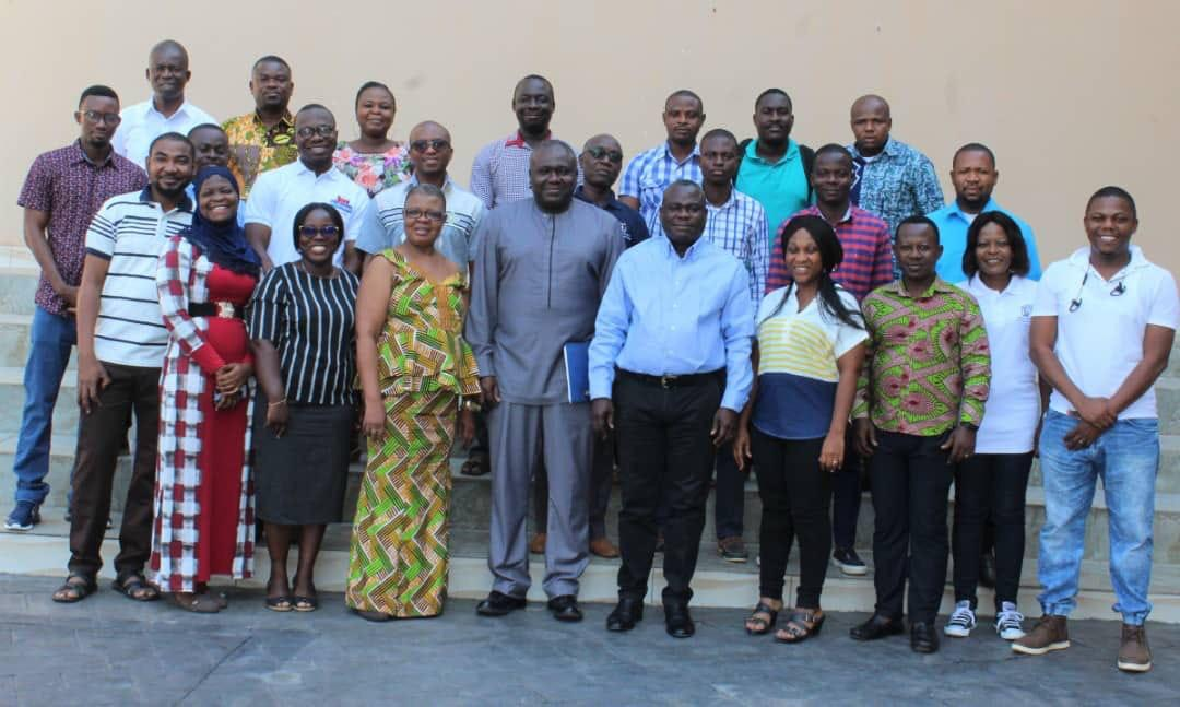 Mr Phillip Abradu-Otoo (5th left), Director of Research, BoG, with some officials of the BoG and some members of the IFEJ