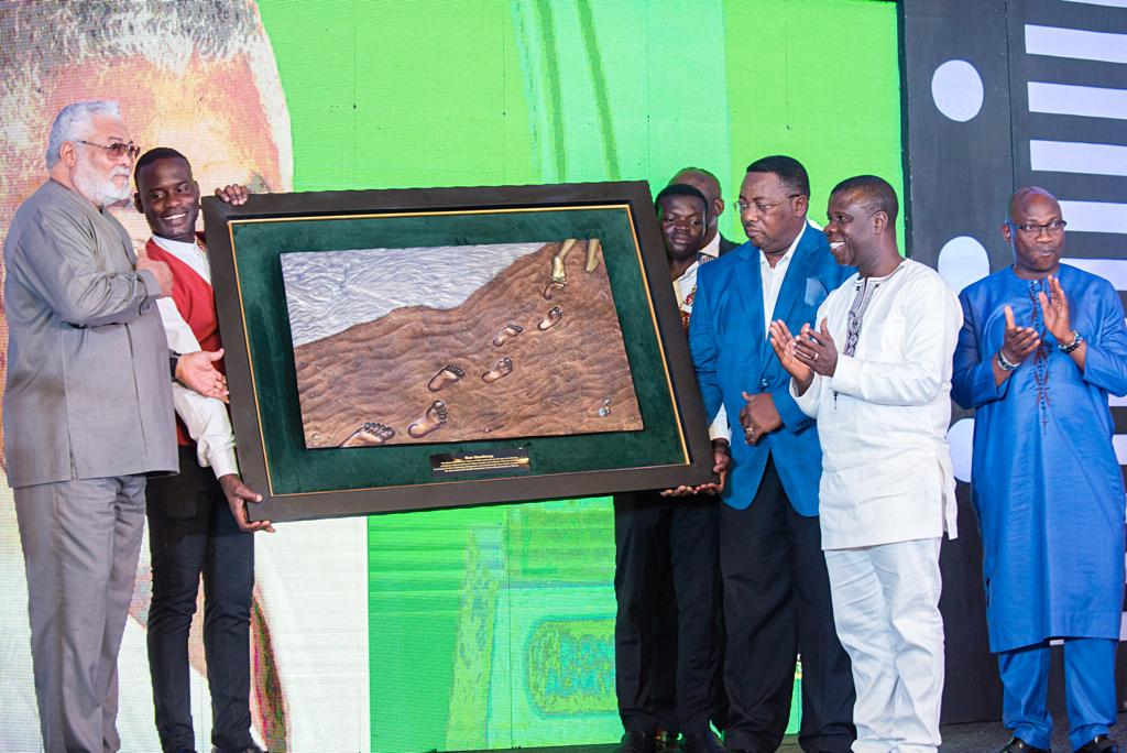 Mr Prince William Ankrah (3rd right) presenting the award to Former President Jerry John Rawlings (left).