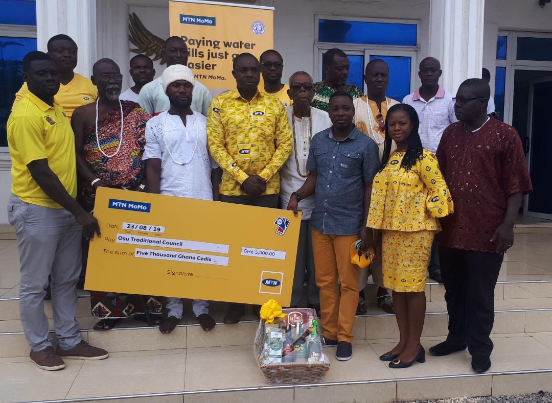 The MTN team presenting the dummy cheque to the Osu Traditional Council