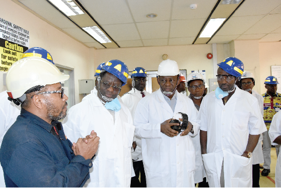 Mr John Peter Amewu (2nd left), the Minister of Energy, and Mr Isaac Osei (2nd right), the MD, Tema Oil Refinery, being briefed on the operations of the refinery during the tour. With them include Mr John Boadu (right), Board Member, TOR